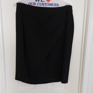 Black skirt with draping detail.